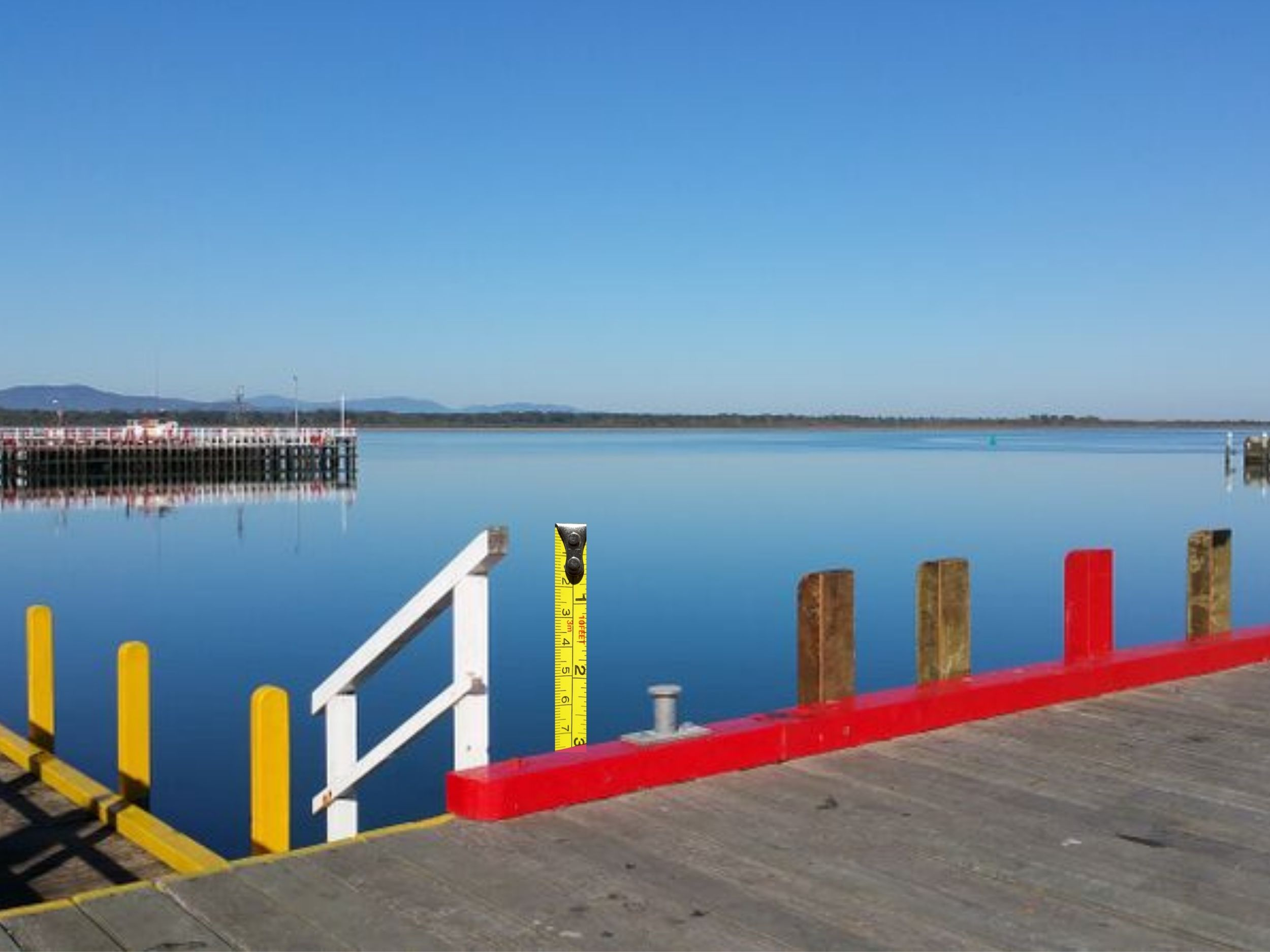 measure tape superimposed on wharf scene